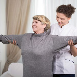 Woman receiving physical therapy at home