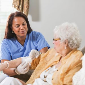 Woman receiving wound care at home