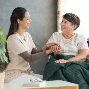Nurse caring for senior woman